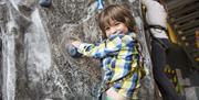 Child climbing at Action Stations