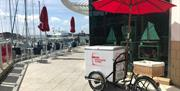 Cool down with a treat from the Ice Cream Bike at the Waterfront Cafe