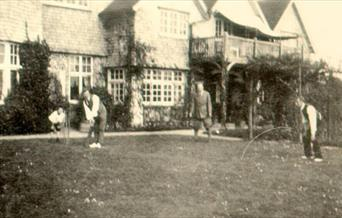 Photograph of  Sir Arthur Conan Doyle playing cricket at Windlesham Manor