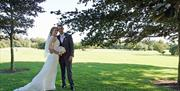 Newlyweds enjoying the Cams Hall Estate Golf Club grounds.