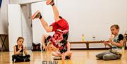 Youngster breakdancing at Funk Format Street Dance Classes