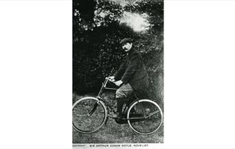 Photograph of Arthur Conan Doyle cycling