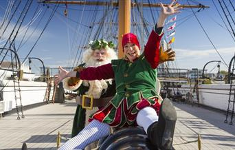 Father Christmas and his elf can't wait to see you at The Victorian Festival of Christmas at Portsmouth Historic Dockyard