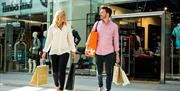 Couple shopping in Gunwharf