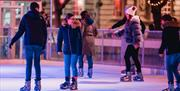 Skaters enjoying the ice at Portsmouth's winter wonderland