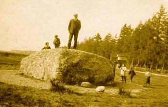 Photograph of Arthur Conan Doyle standing on the Cumberland Stone
