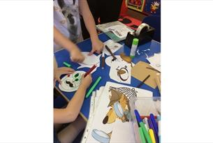 Photograph of children making masks