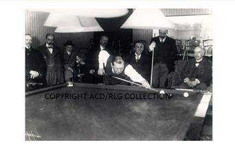 Photograph of Arthur Conan Doyle playing billiards