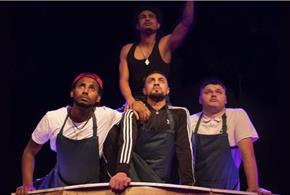 The four boys midway through preforming their show