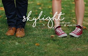 Poster showing two pairs of feet and the word skylight