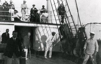 Photograph of Conan Doyle playing cricket at sea